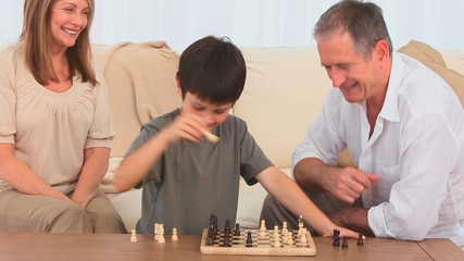 A game of chess between a grandfather and his grandson
