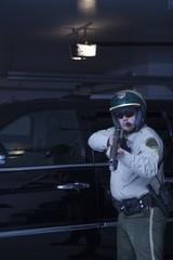 Nightwatch patrolman aims rifle