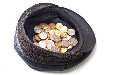 Coins in old cap