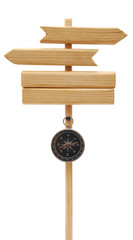 wooden arrows road sign with compass