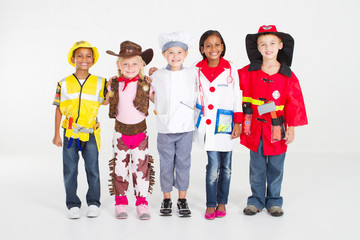 happy kids in halloween uniforms