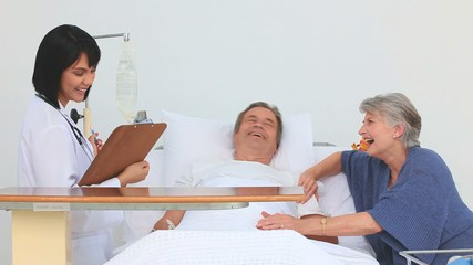 Couple receiving a visit of the nurse