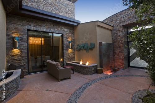 Exterior with patio furniture and lights