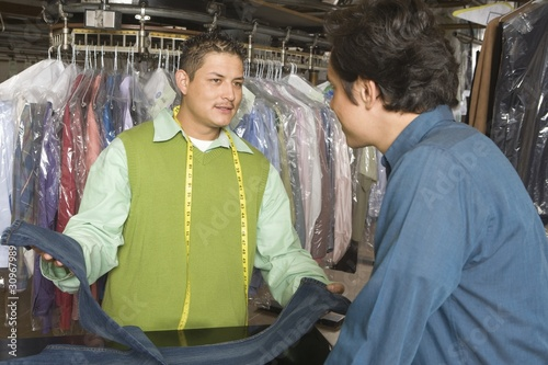 Man serving customer in the laundrette