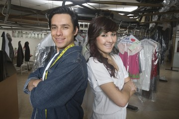 Two people working in laundrette