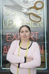 Woman standing infront of laundrette shop window