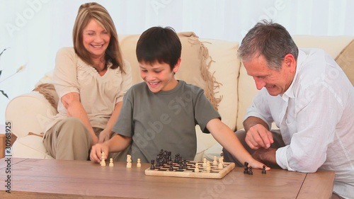 Little boy playing chess