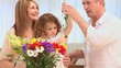 Family putting on flowers in a vase