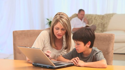 Woman with her grandson using a laptop