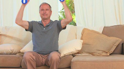 Middle aged man doing exercise of musculation