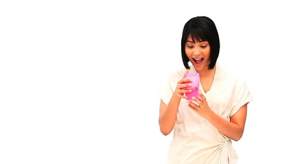 Cute asian woman opening a gift