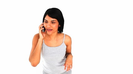 Brunette chinese woman laughing on the phone