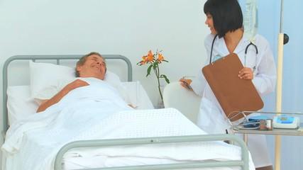 Elderly man receiving a visit of his nurse