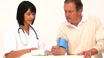 Asian nurse checking the blood pressure