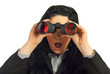 Amazed business woman with binocular