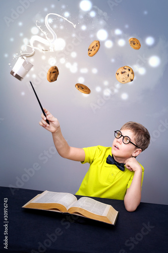 Little boy doing a magic
