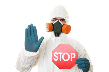 Man in protective suit with a sign STOP