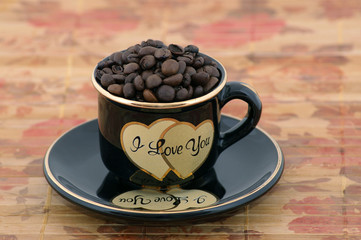 coffee beans in cup (i love you)
