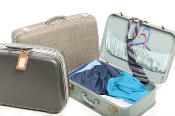 Close-up of three old suitcases