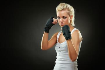 Beautiful boxer girl with black bandage on hands