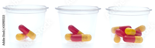 Three containers with different amount of pills