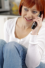 Young female chatting on the phone