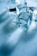 abstract backgrounds with ice cubes over wet glass