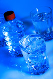 still-life with purified spring water in glass and bottle poster