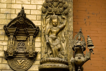 Bronze  Deity at wall in Nepal temple 1.