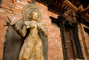 Bronze Deity  front of temple at Patan Durbar Square, Nepal.