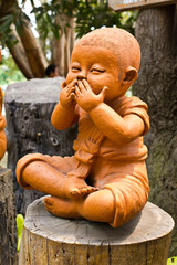 statue of a cute little monk
