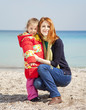 Two sisters at the beach in spring day.