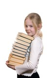 Schoolgirl holding pile of books isolated on white background