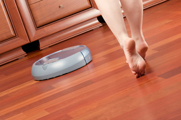 Home cleaning robot and woman