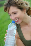 Beautiful blond woman drinking natural water