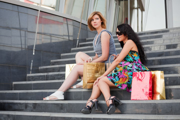 Two young women sitting on the mall steps