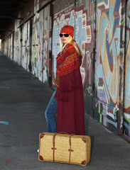 Woman with an old fashioned suitcase Waiting