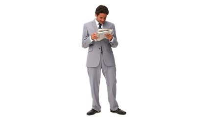 Elegant business man reading a newspaper