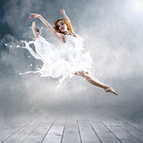 Jump of ballerina with dress of milk