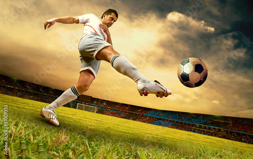 Plexiglas voetbal Happiness football player on field of olimpic stadium on sunrise