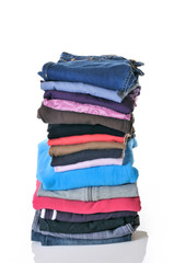 pile of folded clothes on white background