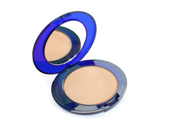 The beige powder in blue box with mirror