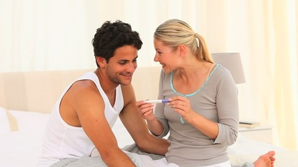 Couple with a pregnancy test