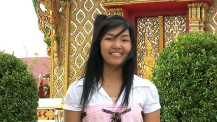 Asian Girl Doing Thai Style Greeting