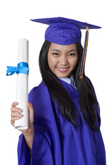 Asian student holding graduation degree