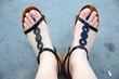 feet in black sandals