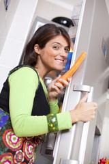 Woman open the refrigerator door