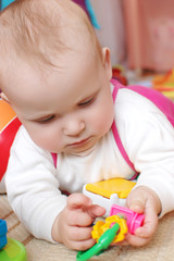 Baby Playing Concentrated