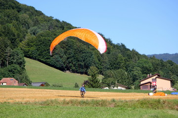 Paraglider landing in a field
