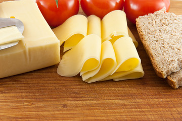 Plate with cheese and tomatoes and bread